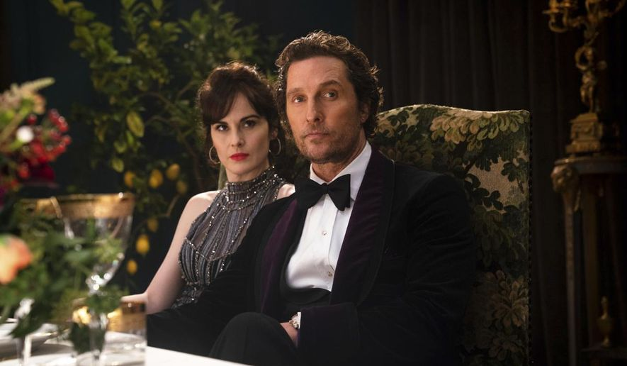 """This image released by STXfilms shows Michelle Dockery, left, and Matthew McConaughey in a scene from """"The Gentlemen."""" (Christopher Raphael/STXfilms via AP) ** FILE **"""