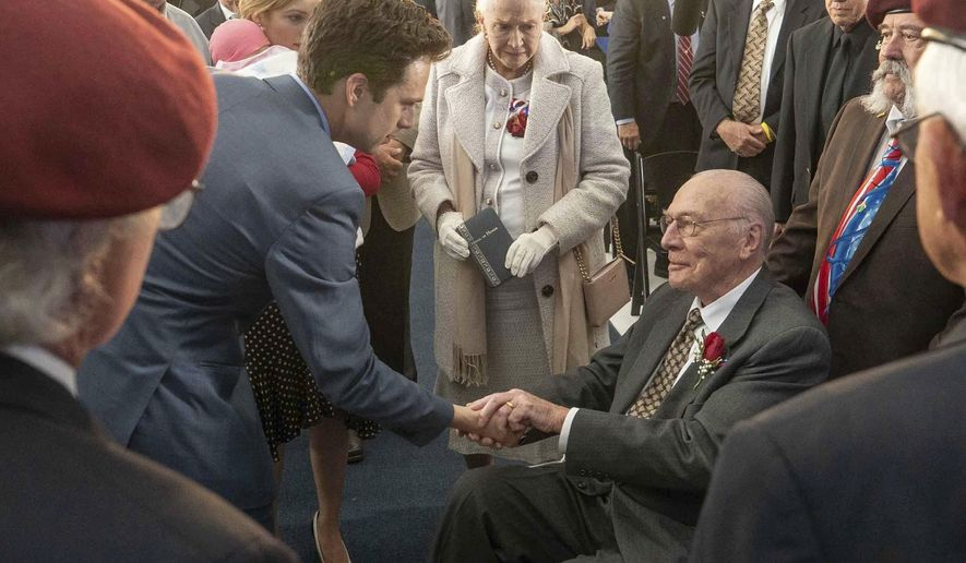 """This image released by Roadside Attractions shows, from left, Sebastian Stan, Diane Ladd and Christopher Plummer in a scene from """"The Last Full Measure."""" (Tina Rowden/Roadside Attractions via AP)"""