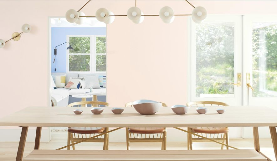 """This photo provided by Benjamin Moore shows a room with Benjamin Moor'es 2020 Color of the Year called First Light, a dreamy, soft shade of pink. Director of Color Marketing & Development Andrea Magno says that while the color was already part of the 3500-hue library, """"it's always fortuitous when the trend concept and color name complement one another. While descriptions like 'light pink' are quite straightforward, we also look for names that evoke positive associations and experiences."""" (Benjamin Moore via AP)"""