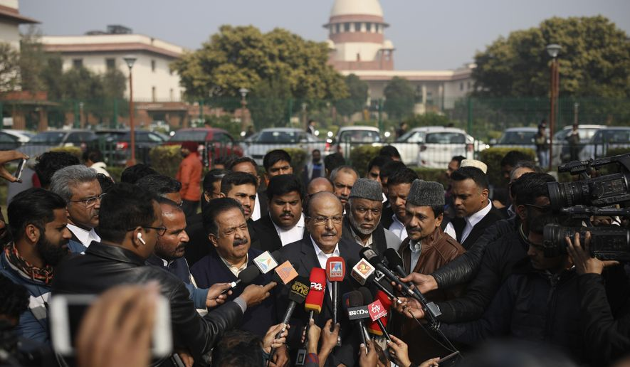 Indian Union Muslim League leader P.K.Kunhalikutty, center, one of the petitioners, speaks to media on the lawns of India's Supreme Court after the top court started hearing dozens of petitions that seek revocation of a new citizenship law amendment in New Delhi, India, Wednesday, Jan. 22, 2020. The new law had led to nationwide demonstrations and a violent security backlash resulting in the death of more than 20 people. (AP Photo/Altaf Qadri)
