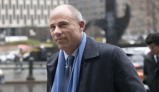 FILE - In this Dec. 17, 2019, file photo, California attorney Michael Avenatti arrives at federal court in New York to enter a plea to an indictment charging him with trying to extort up to $25 million from Nike. An attorney for Avenatti says his client cannot properly prepare for his extortion trial while he is housed in drug kingpin El Chapo's chilly former cell. Attorney Scott Srebnick wrote in a letter to a federal judge Sunday, Jan. 19, 2020, that the onetime lawyer for porn star Stormy Daniels needs to be transferred from solitary confinement at the Metropolitan Correctional Center in New York City to the general population in the federal lockup. (AP Photo/Mark Lennihan, File )