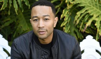 """FILE - This Nov. 21, 2016 file photo shows singer-songwriter John Legend during a portrait session in West Hollywood, Calif. Legend is nominated for a Grammy for best traditional pop vocal album with his holiday album, """"A Legendary Christmas.""""(Photo by Chris Pizzello/Invision/AP, File)"""