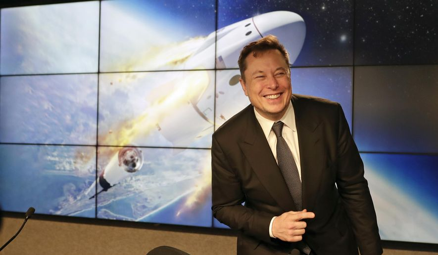 In this Jan. 19, 2020, file photo Elon Musk, founder, CEO, and chief engineer/designer of SpaceX speaks during a news conference at the Kennedy Space Center in Cape Canaveral, Fla. The meteoric rise of Tesla shares that pushed the company's value over $100 billion could turn into a supercharged payday for CEO Elon Musk. (AP Photo/John Raoux, FIle)