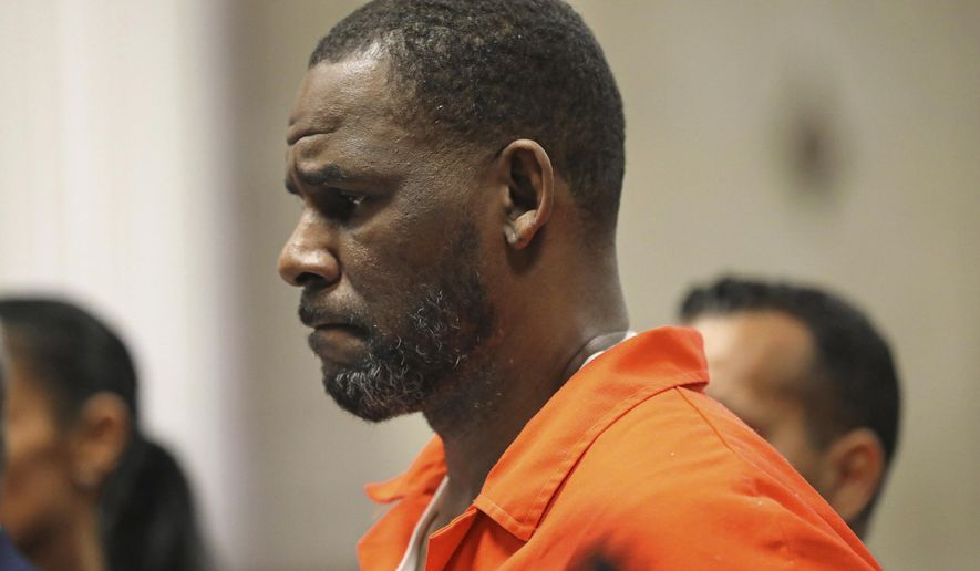 FILE - In this Sept. 17, 2019 file photo, R. Kelly appears during a hearing at the Leighton Criminal Courthouse in Chicago. State prosecutors said Wednesday, Jan. 22, 2020, that the first of the four Chicago sexual abuse cases against Kelly that they'll take to trial involves a hairdresser who alleges that Kelly tried to force himself on her during a 2003 appointment. Kelly, who remains jailed, faces a raft of charges in several jurisdictions, including four separate indictments on Illinois state charges involving four women who accuse the singer of sexually abusing them during a roughly 10-year period starting in the late 1990s. (Antonio Perez/Chicago Tribune via AP, Pool, File)