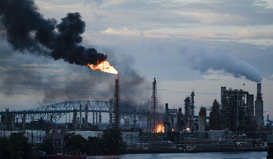 FILE - In this June 21, 2019, file photo, flames and smoke emerge from the Philadelphia Energy Solutions Refining Complex in Philadelphia. Hilco Redevelopment aims to move quickly to clean up the 1,300-acre South Philadelphia refinery complex and redevelop it into a mixed-use industrial facility. (AP Photo/Matt Rourke, File)