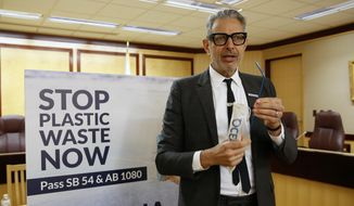 Actor Jeff Goldblum displays a reusable metal straw as he discusses two bills aimed at reducing single-use plastic packaging and products, like plastic straws and food containers at a Capitol news conference in Sacramento, Calif., Wednesday, Jan. 22, 2020. If approved by lawmakers and signed by the governor, California would become the first-in-the-nation to adopt measures to rein in waste for single-use plastic containers and items. (AP Photo/Rich Pedroncelli)