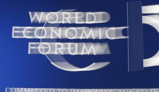 The World Economic Forum logo is seen in Davos, Switzerland, Tuesday, Jan. 21, 2020. The 50th annual meeting of the forum will take place in Davos from Jan. 21 until Jan. 24, 2020. (AP Photo/Michael Probst)