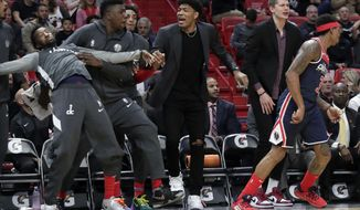Washington Wizards forward Rui Hachimura, third from left, reacts with his teammates from the bench during the first half of an NBA basketball game against the Miami Heat, Wednesday, Jan. 22, 2020, in Miami. (AP Photo/Lynne Sladky)