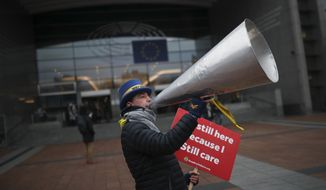 Anti-Brexit campaigner Steve Bray reacts to the photographer after a protest outside the European Parliament in Brussels, Thursday, Jan. 23, 2020. (AP Photo/Francisco Seco)