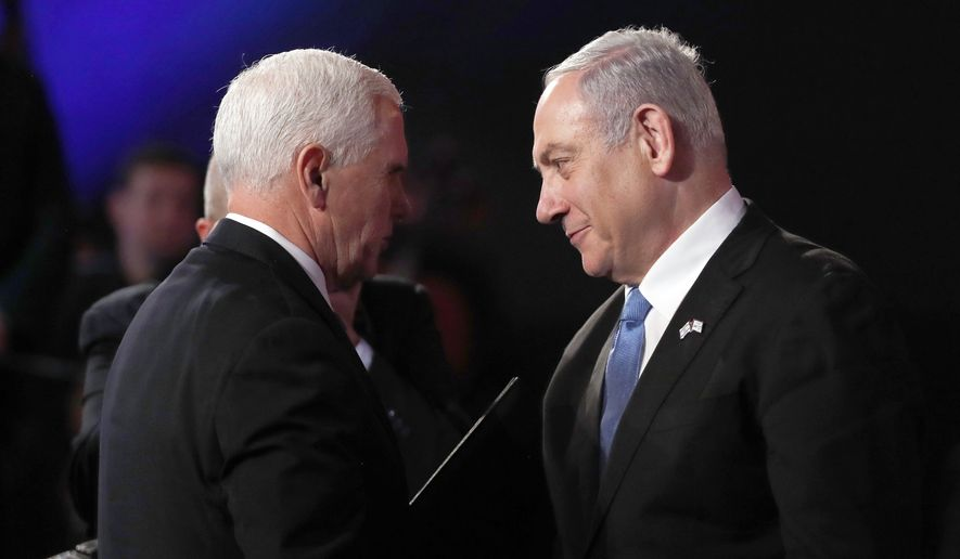 U.S. Vice President Mike Pence and Israeli Prime Minister Benjamin Netanyahu greet each other at the World Holocaust Forum in Jerusalem on Thursday, Jan. 23, 2020.  January 2020. More than 40 dignitaries are attending the World Holocaust Forum, which coincides with the 75th anniversary of the liberation of the Auschwitz death camp.  (Ronen Zvulun/Pool Photo via AP)