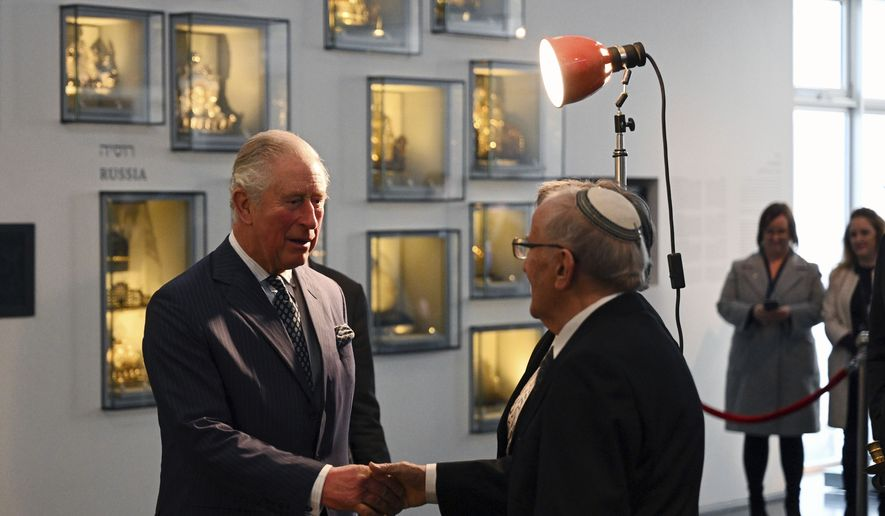 Britain's Prince Charles, left, joins a reception for British Holocaust survivors at the Israel Museum in Jerusalem, Thursday Jan. 23, 2020. Prince Charles is among dozens of presidents, heads of state and dignitaries who have descended upon the city to attend the largest-ever gathering focused on commemorating the Holocaust and combating modern-day anti-Semitism. (Neil Hall/Pool via AP)