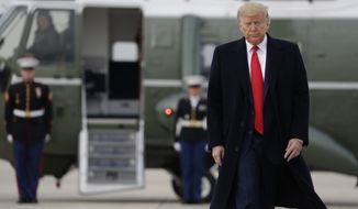 President Donald Trump arrives to board Air Force One for a trip to Miami to attend the Republican National Committee winter meetings, Thursday, Jan. 23, 2020, in Andrews Air Force Base, Md. (AP Photo/ Evan Vucci)