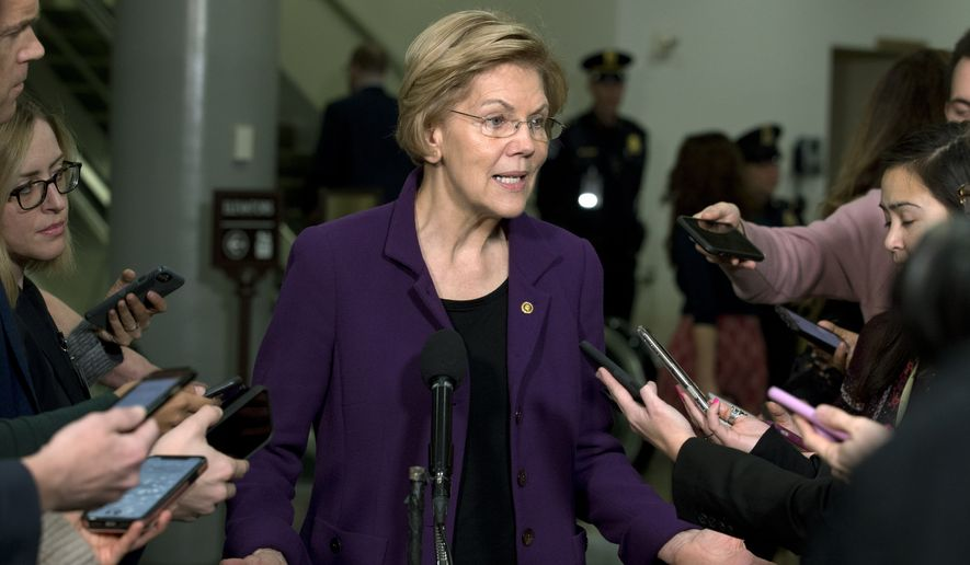 Democratic presidential candidate Sen. Elizabeth Warren, D-Mass., talks to the media as she walks to the Senate chamber prior to the start of the impeachment trial of President Donald Trump at the U.S. Capitol, Thursday, Jan. 23, 2020, in Washington. (AP Photo/Jose Luis Magana)