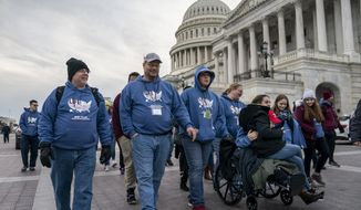 As the impeachment trial of President Donald Trump is conducted inside the Senate, activists attending the March for Life anti-abortion rally visit the Capitol in Washington, Thursday, Jan. 23, 2020. The White House says President Trump will become the first president to attend the annual gathering on Friday. (AP Photo/J. Scott Applewhite)