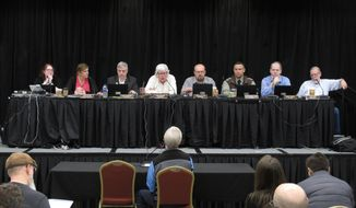 The Alaska Marijuana Control Board listens to testimony during a public comment period on Thursday, Jan. 23, 2020, in Juneau, Alaska. Alaska's legal marijuana industry hit a milestone Thursday, as regulators approved the first retail stores that will be allowed to have customers consume marijuana products on site.(AP Photo/Becky Bohrer)