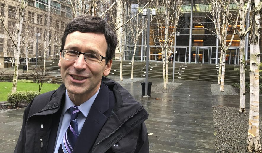 Washington Attorney General Bob Ferguson leaves the U.S. District Court in Seattle Thursday, Jan. 23, 2020, following arguments in his lawsuit challenging the Trump administration's funding of the wall on the U.S.-Mexico border. The administration is diverting $3.6 billion in military construction money, including $89 million for a naval pier in Washington, toward the wall. (AP Photo/Gene Johnson)