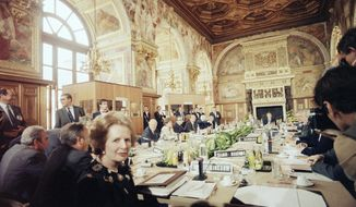 FILE - In this June 25, 1984 file photo, British Prime Minister Margaret Thatcher faces the camera at a summit of European leaders in Fontainebleau, France. At the summit, Thatcher got a financial rebate for Britain. Thatcher's 11-year premiership became increasingly dominated by her opposition to what later became known as the European Union. On Jan. 31, 2020, Britain is scheduled to leave the EU after 47 years. (AP Photo/File)