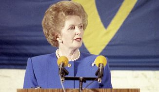 FILE - In this Sept. 20, 1988 file photo, British Prime Minister Margaret Thatcher addresses the opening session of the College of Europe, in Bruges, Belgium. In the speech, Thatcher voiced her growing opposition to calls for more integration between the countries of what became known as the European Union. On Jan. 31, 2020, Britain is scheduled to leave the EU after 47 years. (AP Photo/File)