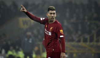 Liverpool's Roberto Firmino gestures during the English Premier League soccer match between Wolverhampton Wanderers and Liverpool at the Molineux Stadium in Wolverhampton, England, Thursday, Jan. 23, 2020. (AP Photo/Rui Vieira)