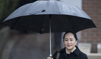 Meng Wanzhou, chief financial officer of Huawei, leaves her home to go to B.C. Supreme Court in Vancouver, Thursday, January, 23, 2020. Wanzhou is in court for hearings over an American request to extradite the executive of the Chinese telecom giant Huawei on fraud charges. (Jonathan Hayward/The Canadian Press via AP)