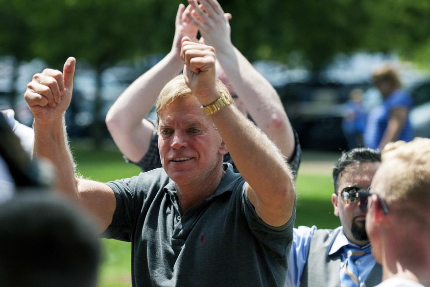 In an Aug. 12, 2017, photo, David Duke arrives to give remarks after a white nationalist protest was declared an unlawful assembly, in Charlottesville, Va. (Shaban Athuman/Richmond Times-Dispatch via AP) **FILE**
