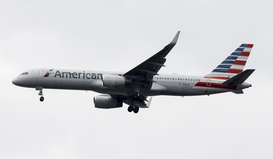 FILE - In this Nov. 7, 2019, file photo an American Airlines jet approaches Philadelphia International Airport in Philadelphia. American Airlines reports financial results Thursday, Jan. 23, 2020. (AP Photo/Matt Rourke, File)