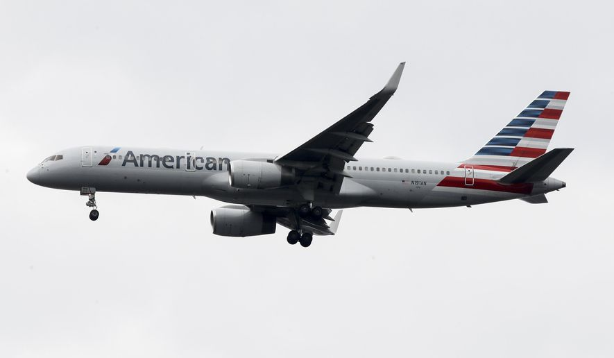 In this Nov. 7, 2019, file photo an American Airlines jet approaches Philadelphia International Airport in Philadelphia. American Airlines reports financial results Thursday, Jan. 23, 2020. (AP Photo/Matt Rourke, File)
