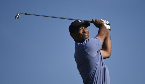 Tiger Woods hits hit tee shot on the 15th hole of the North Course at Torrey Pines Golf Course during the first round of the Farmers Insurance golf tournament Thursday Jan. 23, 2020, in San Diego. (AP Photo/Denis Poroy)