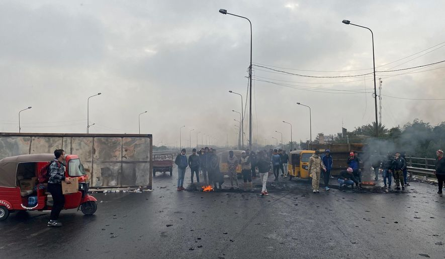 Anti-government protesters continue to shutdown a key highway in downtown Baghdad, Iraq, Thursday, Jan. 23, 2020. (AP Photo/Khalid Mohammed)