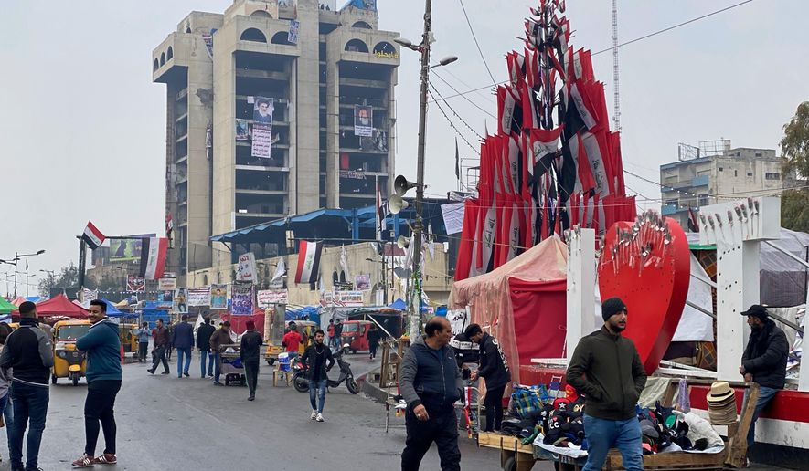 Protesters stage a sit-in at Tahrir Square during anti-government demonstrations in Baghdad, Iraq, Thursday, Jan. 23, 2020. (AP Photo/Khalid Mohammed)