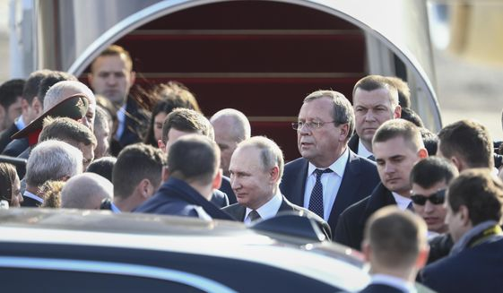 Russian President Vladimir Putin, center, arrives to Tel Aviv airport Thursday, Jan. 23, 2019. ahead of the World Holocaust Forum, which coincides with the 75th anniversary of the liberation of the Auschwitz death camp(AP Photo/Oded Balilty, Pool)