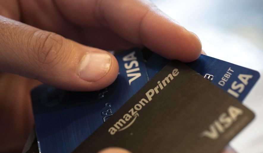 This Aug. 11, 2019 photo shows credit and debit cards in New Orleans. Chase, Capital One, Barclays and other issuers are offering credit cards that reward you handsomely for things like meal delivery, grocery delivery or ride-hailing services. (AP Photo/Jenny Kane)