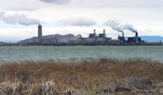 FILE - This April, 2006, file photo shows the Four Corners Power Plant in Waterflow, N.M., near the San Juan River in northwestern New Mexico. The closure of the coal-fired power plant on the Navajo Nation sooner than expected will be a major blow to a region where coal has been a mainstay of the economy for decades.Arizona Public Service Co. now plans to shutter the Four Corners Power Plant in 2031 when its coal contract expires rather than wait until 2038. (AP Photo/Susan Montoya Bryan, File)