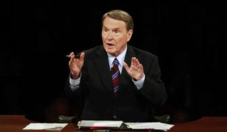 This Sept. 26, 2008, file photo shows debate moderator Jim Lehrer during the first U.S. Presidential Debate between presidential nominees Sen. John McCain, R-Ariz., and Sen. Barack Obama, D-Ill., at the University of Mississippi in Oxford, Miss. PBS announced that PBS NewsHour's Jim Lehrer died Thursday, Jan. 23, 2020, at home. He was 85. (AP Photo/Chip Somodevilla, File)