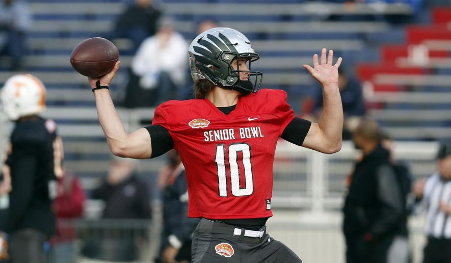 Oregon's Justin Herbert of the South squad runs drills during practice for the Senior Bowl college football game, Wednesday, Jan. 22, 2020, in Mobile, Ala. (AP Photo/Butch Dill) ** FILE **