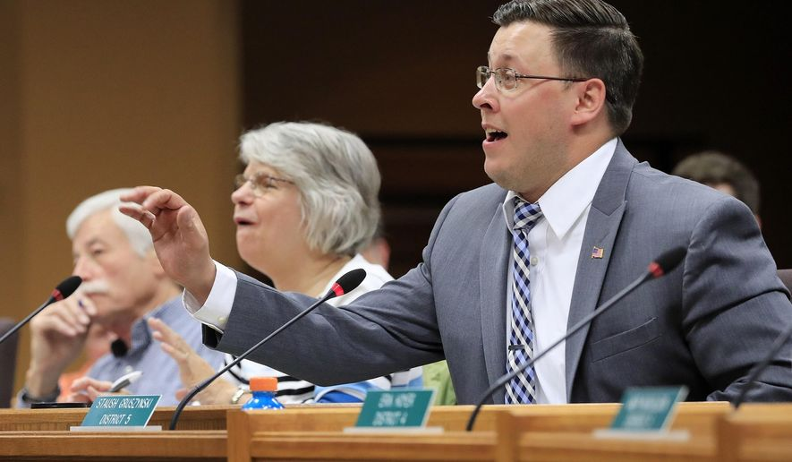 """FILE - In this May 17, 2017 photo, Brown County Supervisor Staush Gruszynski speaks at a Brown County Board of Supervisors meeting at City Hall in Green Bay, Wis. Now a Wisconsin state Rep.,  Grusznyski, in December, was removed from committee assignments and the Democratic caucus after an investigation determined he """"verbally sexually harassed"""" a legislative employee at an offsite location after work hours. He has rejected calls to resign. (Adam Wesley/The Green Bay Press-Gazette via AP)"""