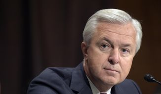 In this Sept. 20, 2016, file photo, Wells Fargo CEO John Stumpf testifies on Capitol Hill in Washington, before the Senate Banking Committee. Federal regulators have slapped former Wells Fargo Chief Executive Stumpf with a $17.5 million fine for his role in the bank's sales practices scandal. (AP Photo/Susan Walsh, File)