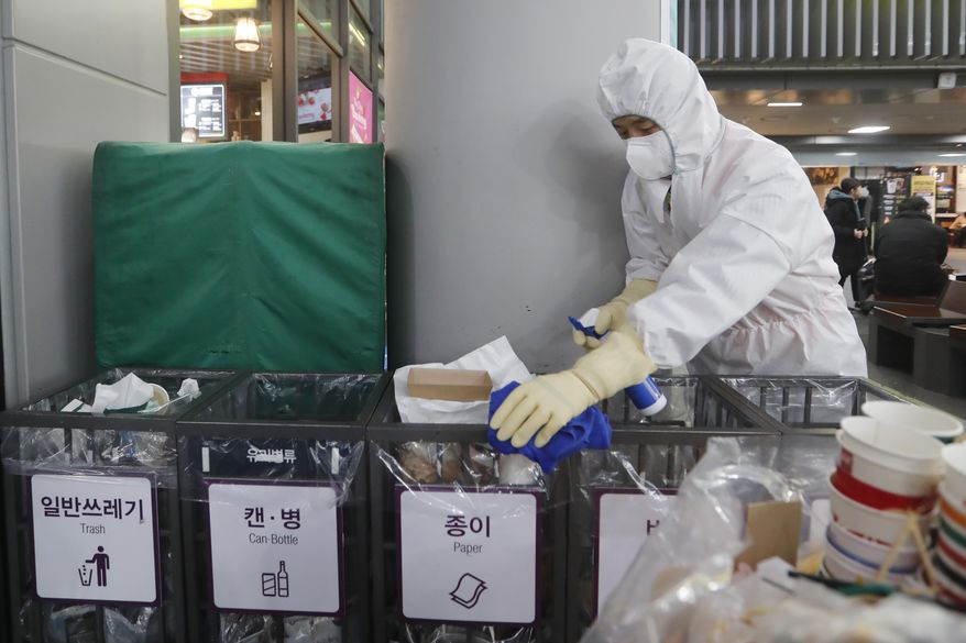 In this Jan. 24, 2020, file photo an employee works to prevent a new coronavirus at Suseo Station in Seoul, South Korea. (AP Photo/Ahn Young-joon, File) **FILE**