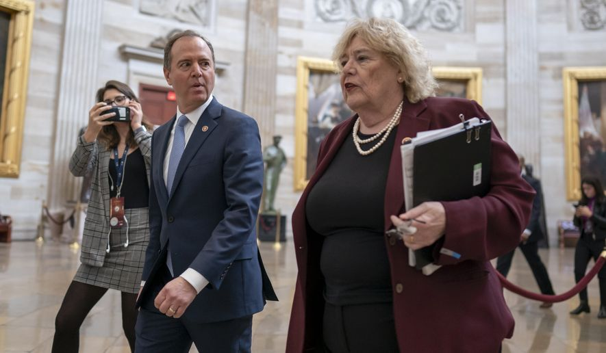 House Intelligence Committee Chairman Adam Schiff, D-Calif., and Rep. Zoe Lofgren, D-Calif., right, walk through the Capitol Rotunda during the impeachment trial of President Donald Trump on charges of abuse of power and obstruction of Congress, in Washington, Friday, Jan. 24, 2020. (AP Photo/J. Scott Applewhite)