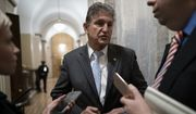 Sen. Joe Manchin, D-W.Va., departs the Capitol as the Senate finishes its work for the day in the impeachment trial of President Donald Trump on charges of abuse of power and obstruction of Congress, in Washington, Friday, Jan. 24, 2020. (AP Photo/J. Scott Applewhite) ** FILE **