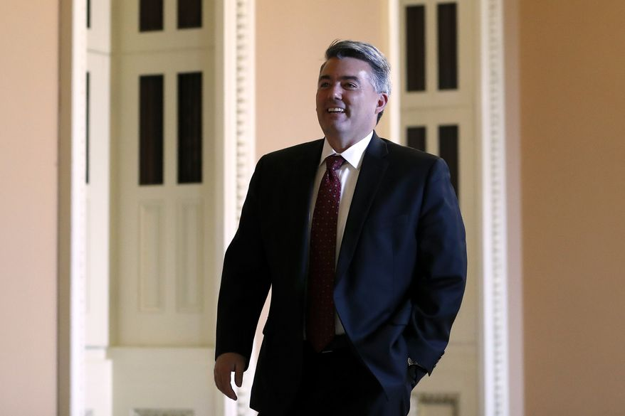 Sen. Cory Gardner, R-Colo., walks to the Senate chamber at the Capitol in Washington during the impeachment trial of President Donald Trump on charges of abuse of power and obstruction of Congress, Friday, Jan. 24, 2020. (AP Photo/Julio Cortez)