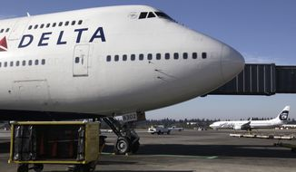 FILE - In this Oct. 9, 2012 file photo, Delta Air Lines 747-400 airplane sits parked at Seattle-Tacoma International Airport in Seattle. Delta Air Lines is being fined $50,000 for ordering Muslim passengers off planes even after the airline's own security officials cleared them to travel , Friday, Jan. 24, 2020. (AP Photo/Ted S. Warren, File)