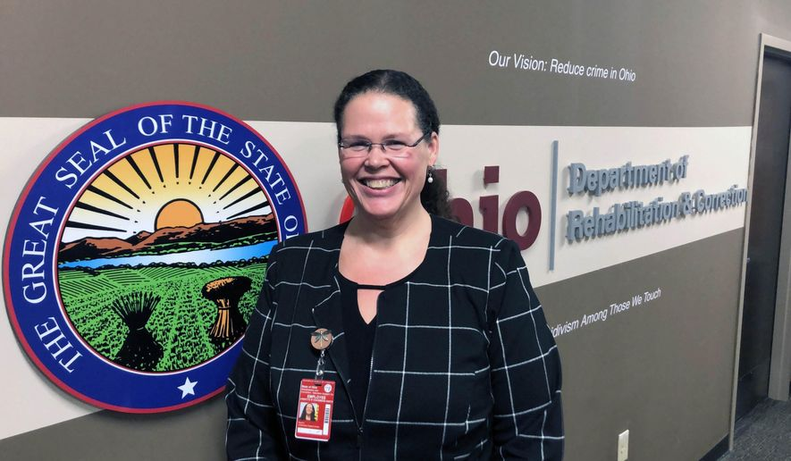 """In this Wednesday, Jan. 22, 2020 photo, Annette Chambers-Smith, director of the Ohio Department of Rehabilitation and Correction, poses outside her office in Columbus, Ohio. Smith says the prisons agency wants to replace or renovate some of its high-security prisons in the near future, saying its current facilities for violent inmates are """"functionally obsolete and creating security risks for the agency. (AP Photo/Andrew Welsh-Huggins)"""