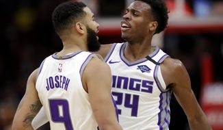 Sacramento Kings guard Cory Joseph, left, celebrates with guard Buddy Hield after scoring basket during the second half of an NBA basketball game against the Chicago Bulls in Chicago, Friday, Jan. 24, 2020. The Kings won 98-81.(AP Photo/Nam Y. Huh)