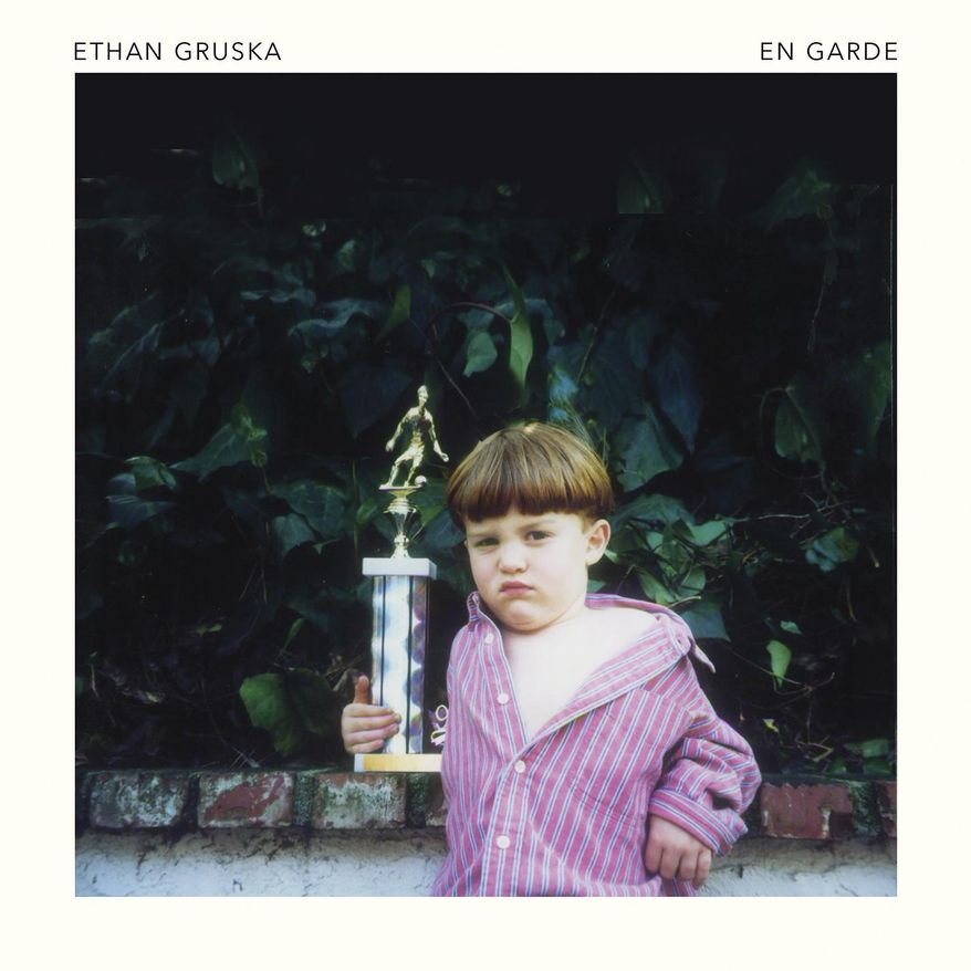 "This cover image released by Warner Bros. shows ""En Garde,"" a release by Ethan Gruska. (Warner Bros. via AP)"
