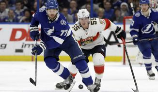Tampa Bay Lightning defenseman Victor Hedman (77) moves the puck in front of Florida Panthers center Noel Acciari (55) during the first period of an NHL hockey game Monday, Dec. 23, 2019, in Tampa, Fla. (AP Photo/Chris O'Meara)