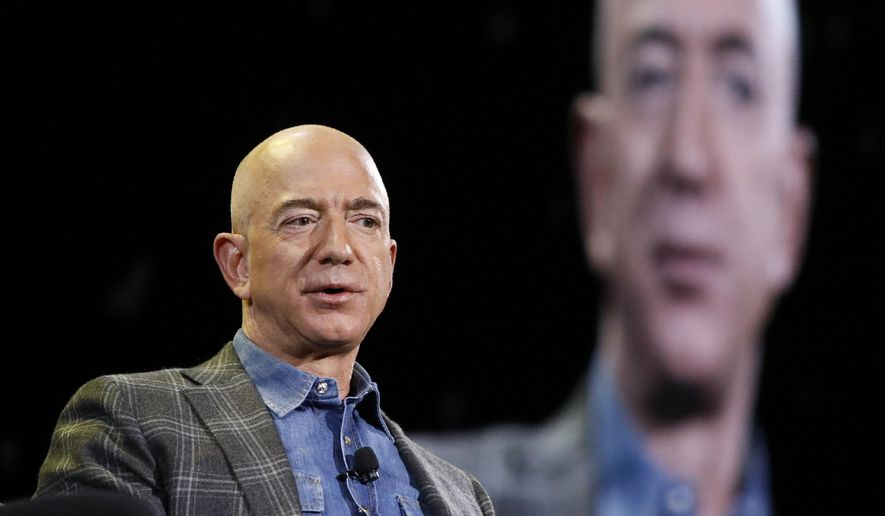 In this June 6, 2019, file photo Amazon CEO Jeff Bezos speaks at the Amazon re:MARS convention in Las Vegas. (AP Photo/John Locher, File)
