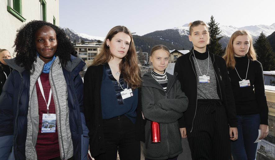 Climate activist Vanessa Nakate, Luisa Neubauer, Greta Thunberg, Isabelle Axelsson and Loukina Tille, from left, arrive for a news conference in Davos, Switzerland, Friday, Jan. 24, 2020. The 50th annual meeting of the forum is taking place in Davos from Jan. 21 until Jan. 24, 2020 (AP Photo/Markus Schreiber)