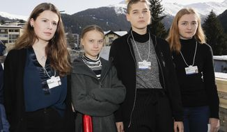Climate activists Luisa Neubauer, Greta Thunberg, Isabelle Axelsson and Loukina Tille, from left, arrive for a news conference in Davos, Switzerland, Friday, Jan. 24, 2020. The 50th annual meeting of the forum is taking place in Davos from Jan. 21 until Jan. 24, 2020 (AP Photo/Markus Schreiber)