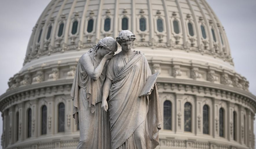 The Capitol Dome looms behind the Peace Monument statue as the impeachment trial of President Donald Trump on charges of abuse of power and obstruction of Congress is conducted inside the Senate, in Washington, Thursday, Jan. 23, 2020. (AP Photo/J. Scott Applewhite)